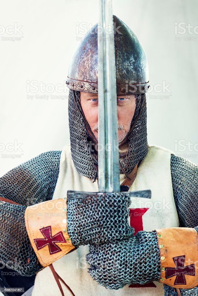 Stern Looking Medieval Knight Holding Large Sword stock photo