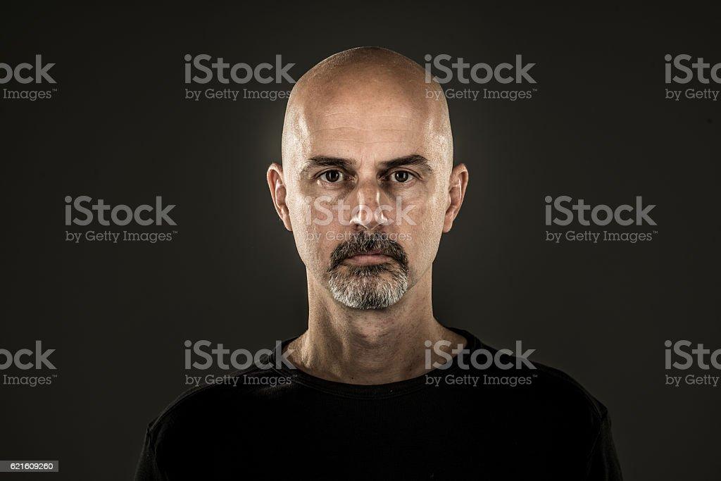 stern man circle beard bald head stock photo