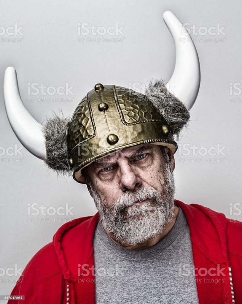 Stern Suspicious Horned Helmet Armor Gray Beard Senior Man stock photo