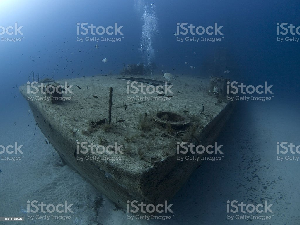 stern view of an artificial reef shipwreck stock photo