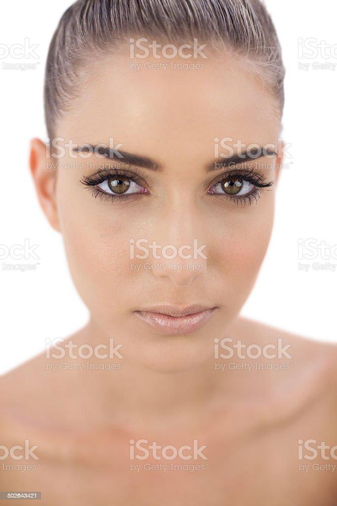 Stern woman looking at camera stock photo