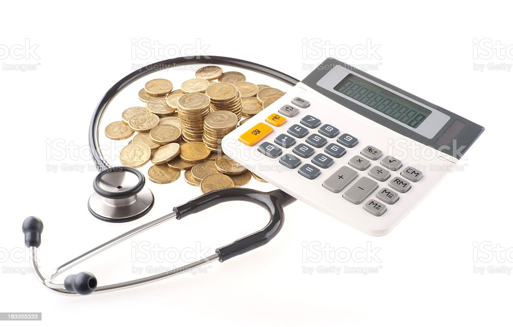 Stethescope and calculator with coins royalty-free stock photo
