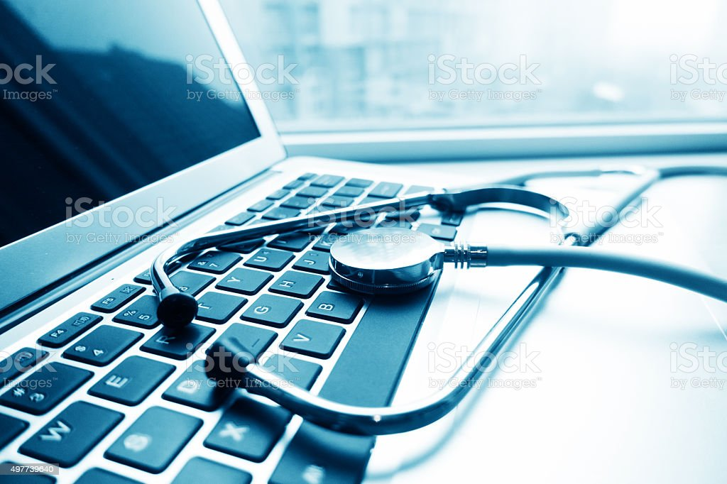 Stethescope on the keyboard of laptop stock photo