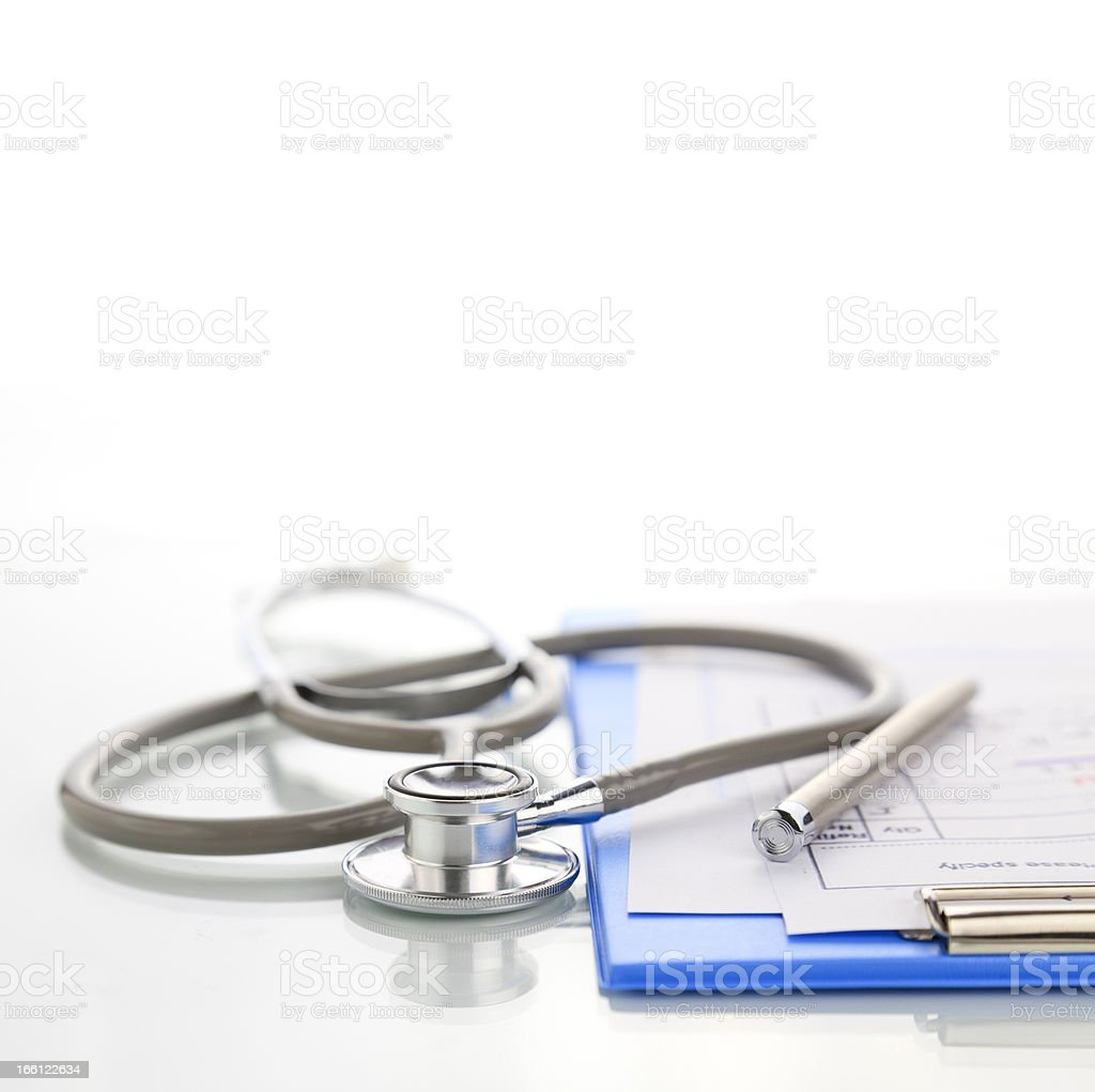 Stethoscope and blue medical clipboard royalty-free stock photo