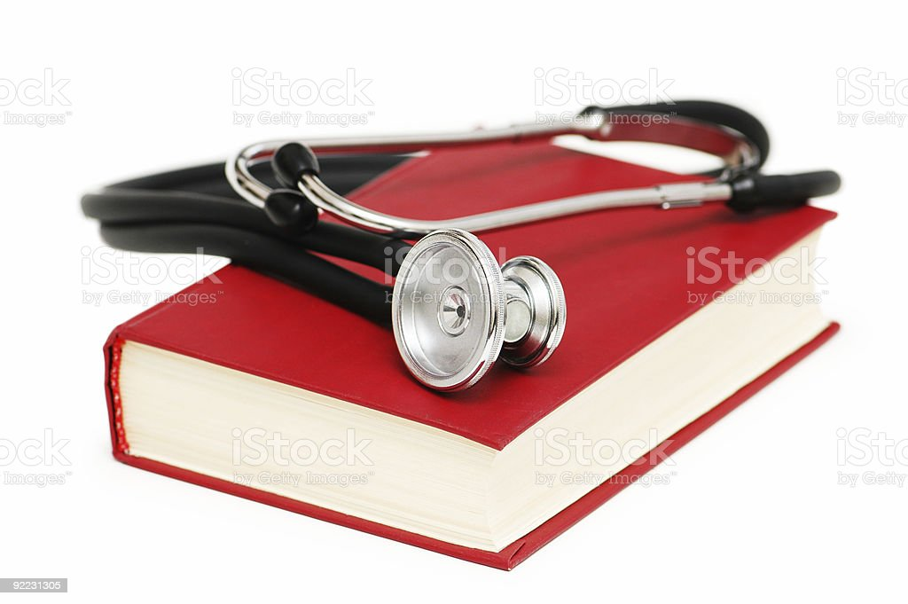 Stethoscope and book isolated on white royalty-free stock photo