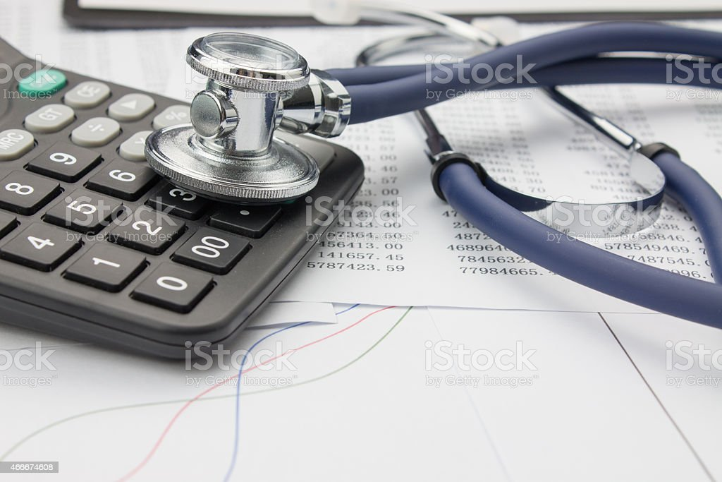 Stethoscope and calculator stock photo