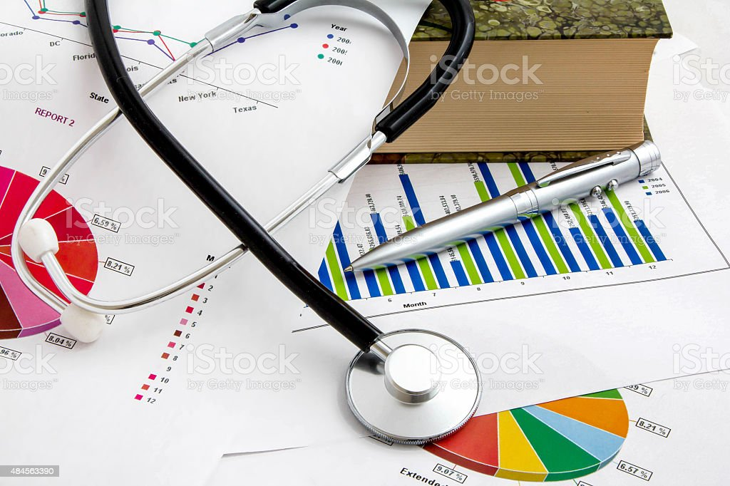 stethoscope and charts stock photo