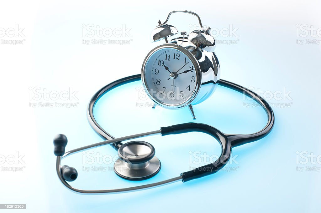 Stethoscope and clock royalty-free stock photo