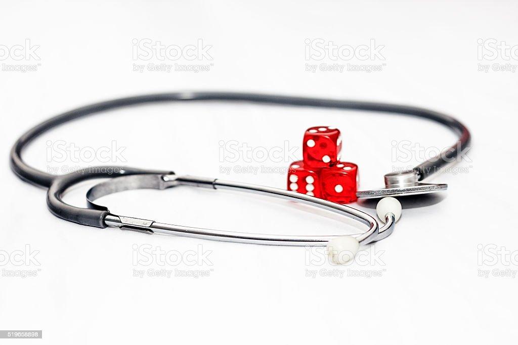 Stethoscope and Dice stock photo