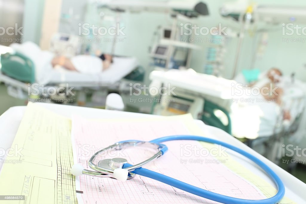 Stethoscope and ECG symbolize clock surveillance for patients stock photo