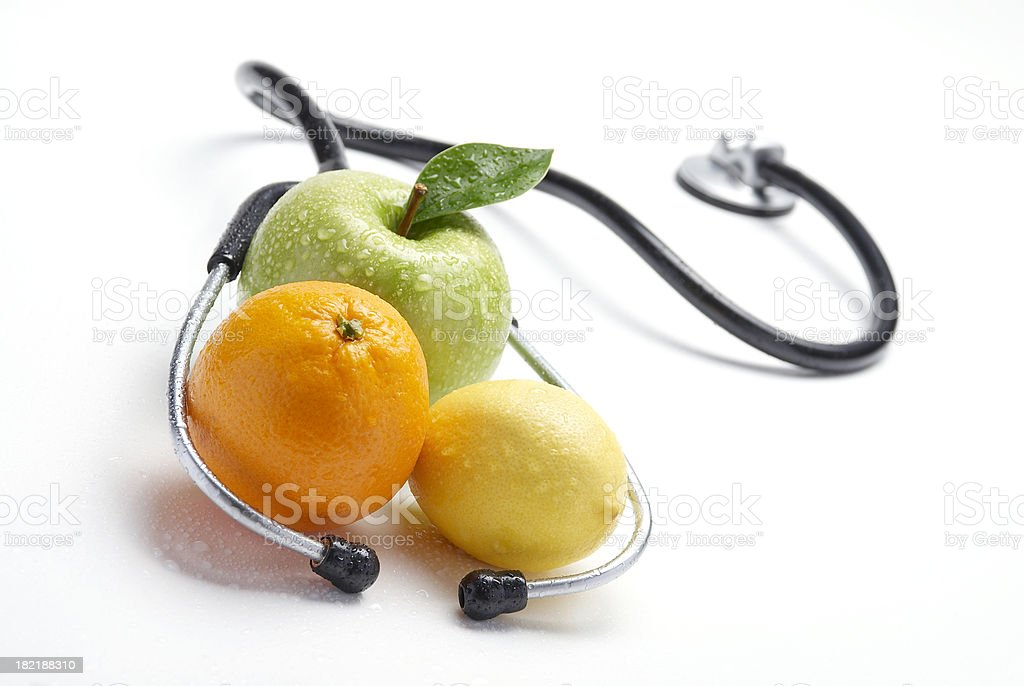 Stethoscope and fresh fruit stock photo
