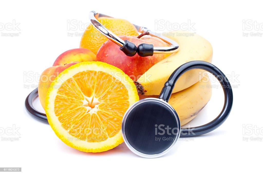 Stethoscope and fruit stock photo