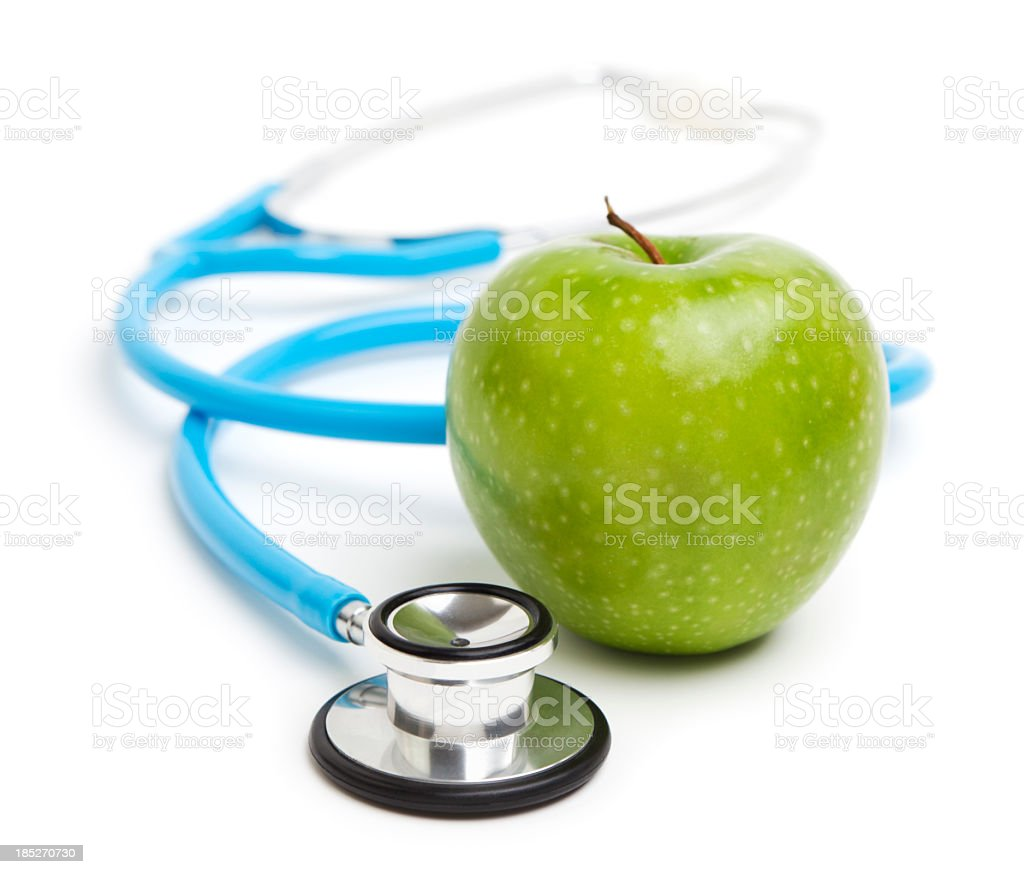 Stethoscope and green apple stock photo