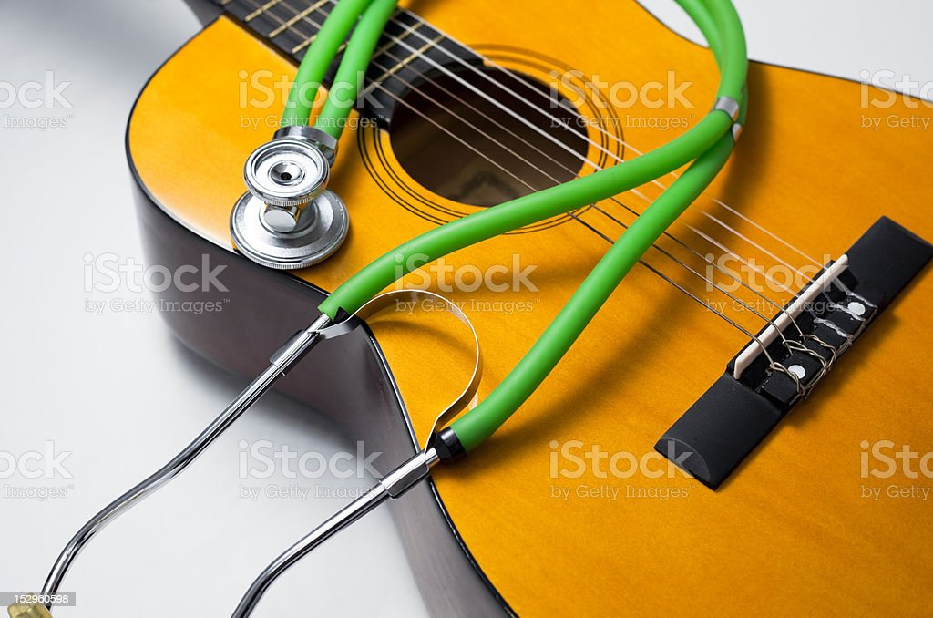 Stethoscope and guitar. royalty-free stock photo