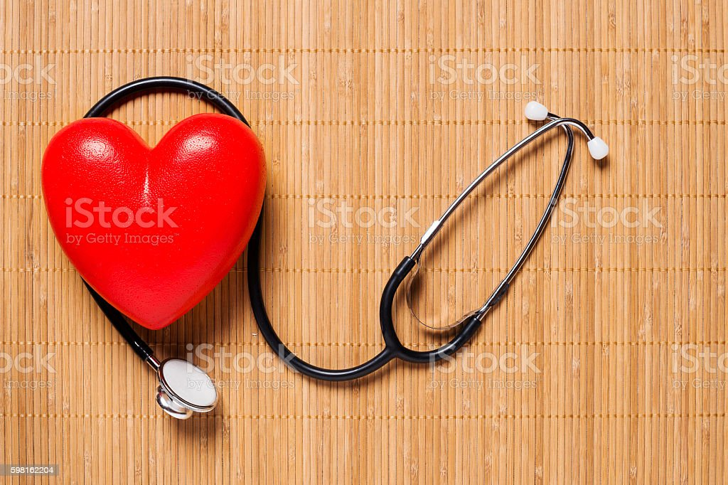 Stethoscope and heart from above, health concept stock photo