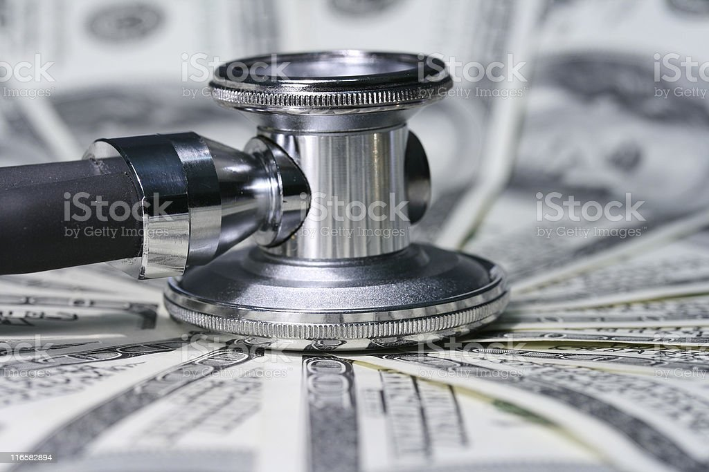 stethoscope and money royalty-free stock photo