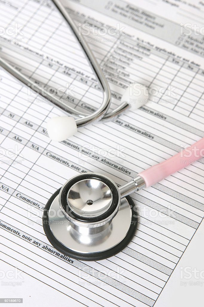 Stethoscope and patient information sheet royalty-free stock photo