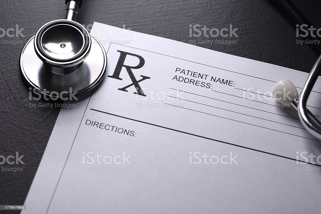 Stethoscope and patient list on black royalty-free stock photo