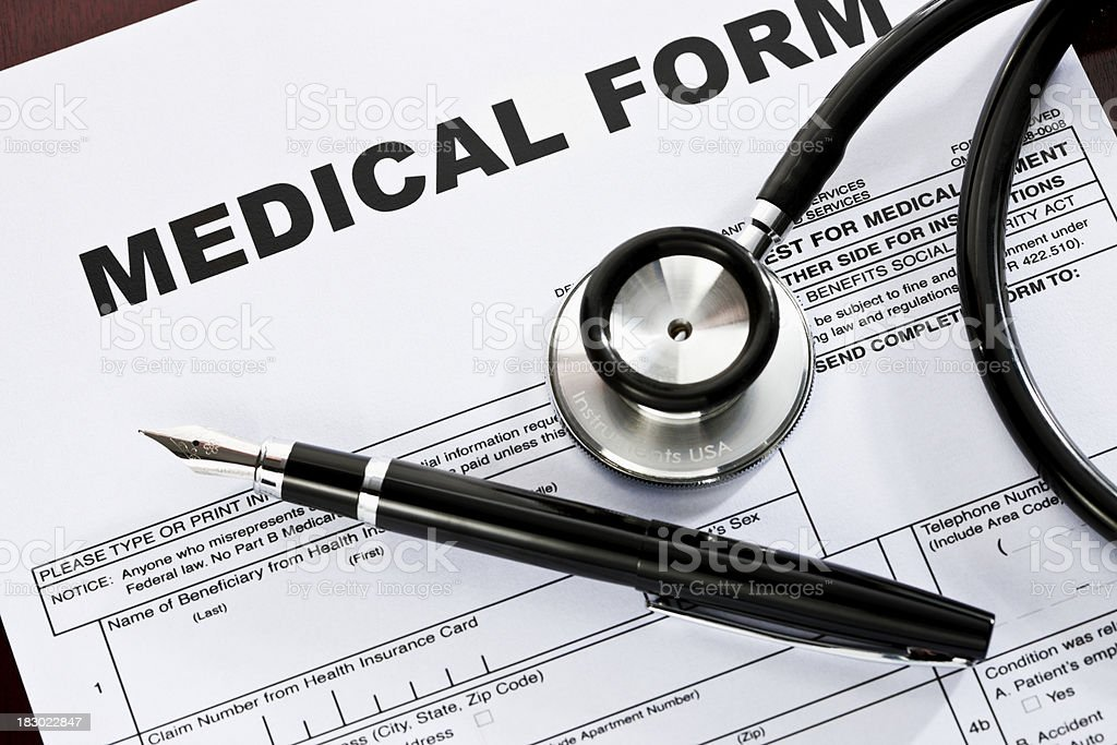 A fountain pen and stethoscope rest atop a blank medical form....