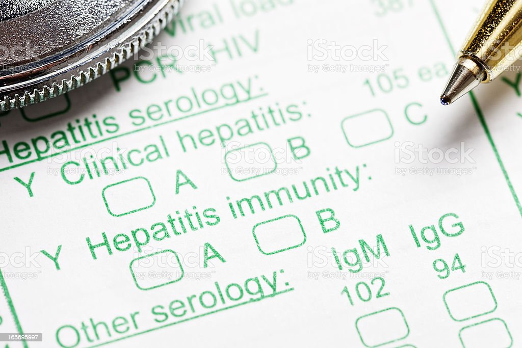 Stethoscope and pen on blood test form for hepatitis royalty-free stock photo