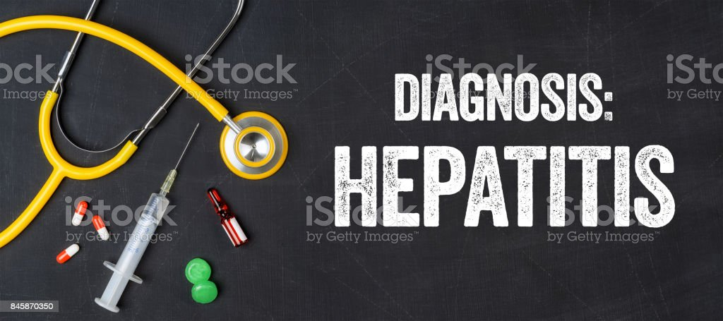 Stethoscope and pharmaceuticals on a blackboard - Hepatitis stock photo