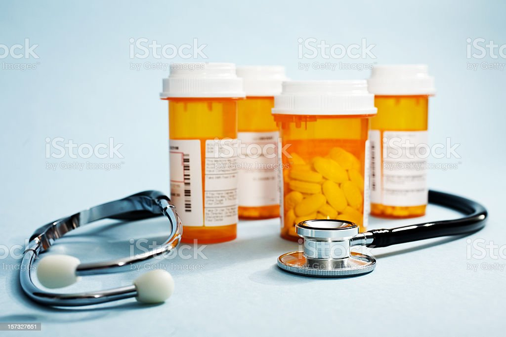 A stethoscope and pill bottles royalty-free stock photo