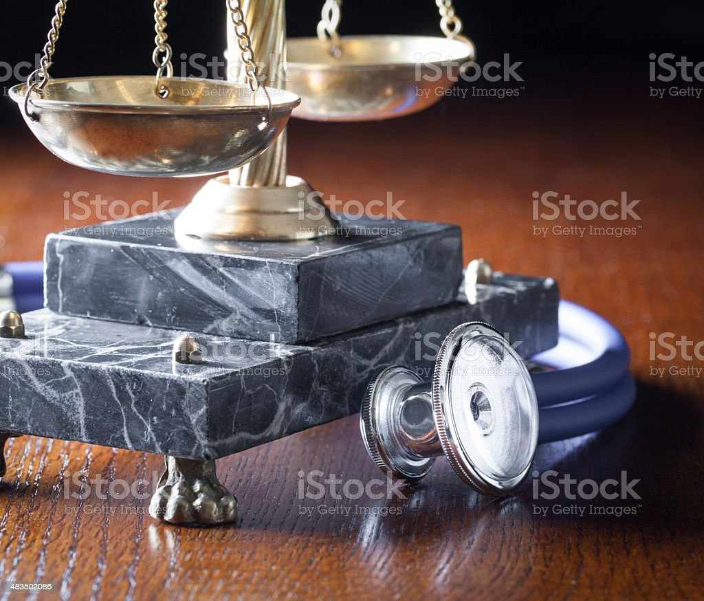 Stethoscope and Scales of Justice stock photo