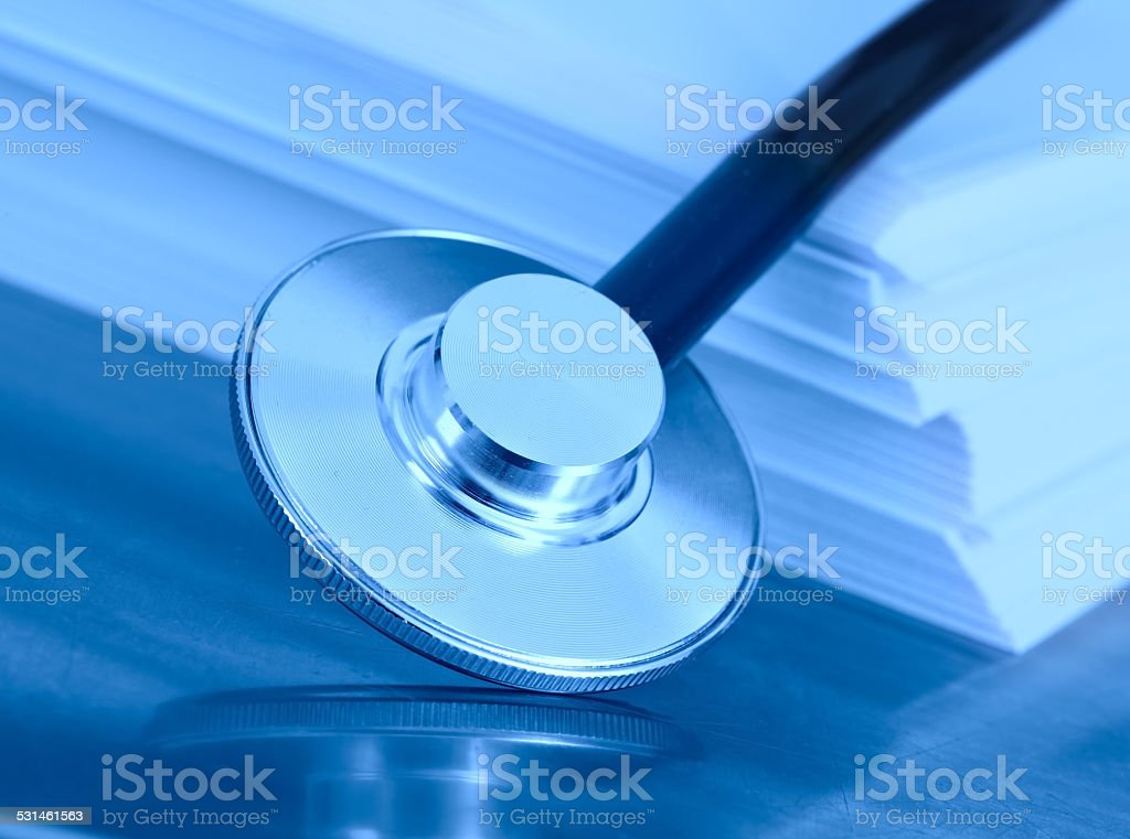 stethoscope and stack of paper. The concept of medical legislation stock photo
