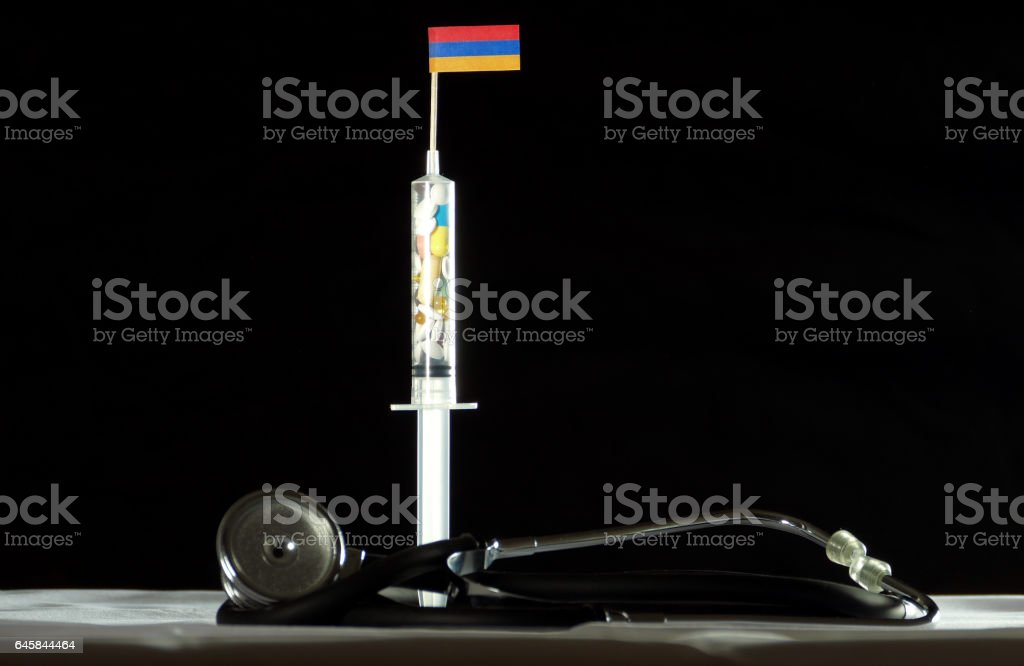 Stethoscope and syringe filled with drugs injecting the Armenian flag stock photo