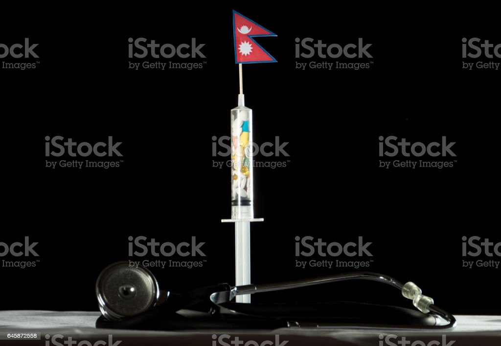 Stethoscope and syringe filled with drugs injecting the Nepalese flag stock photo