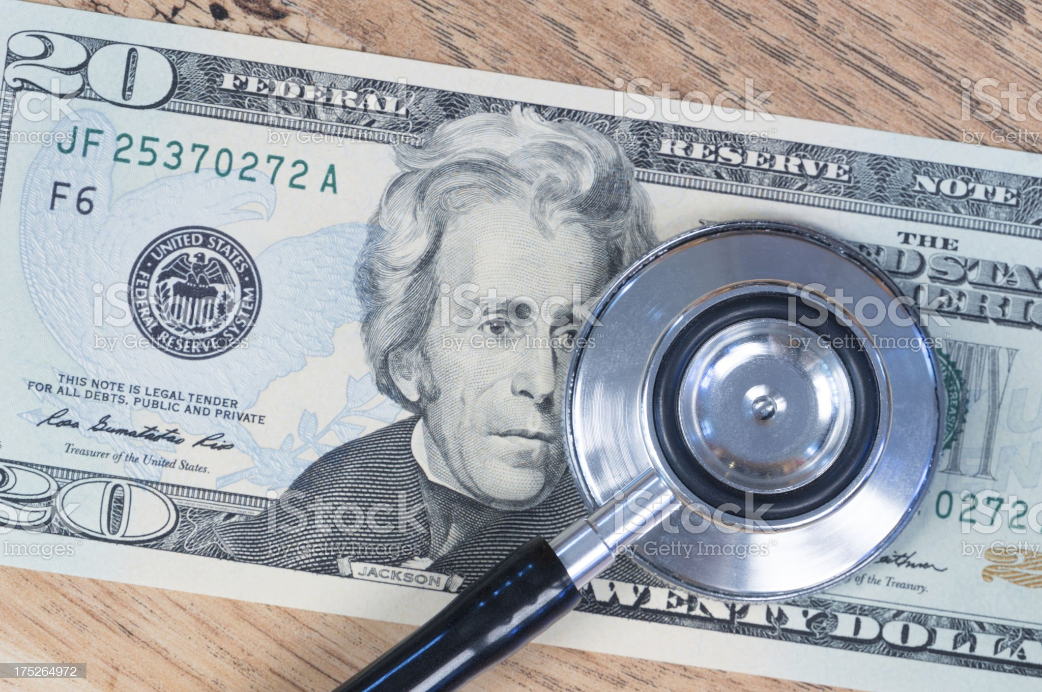 Stethoscope and US Dollar banknote royalty-free stock photo