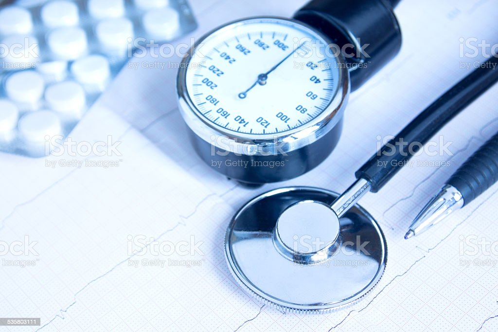 Stethoscope, blood pressure monitor, pills stock photo