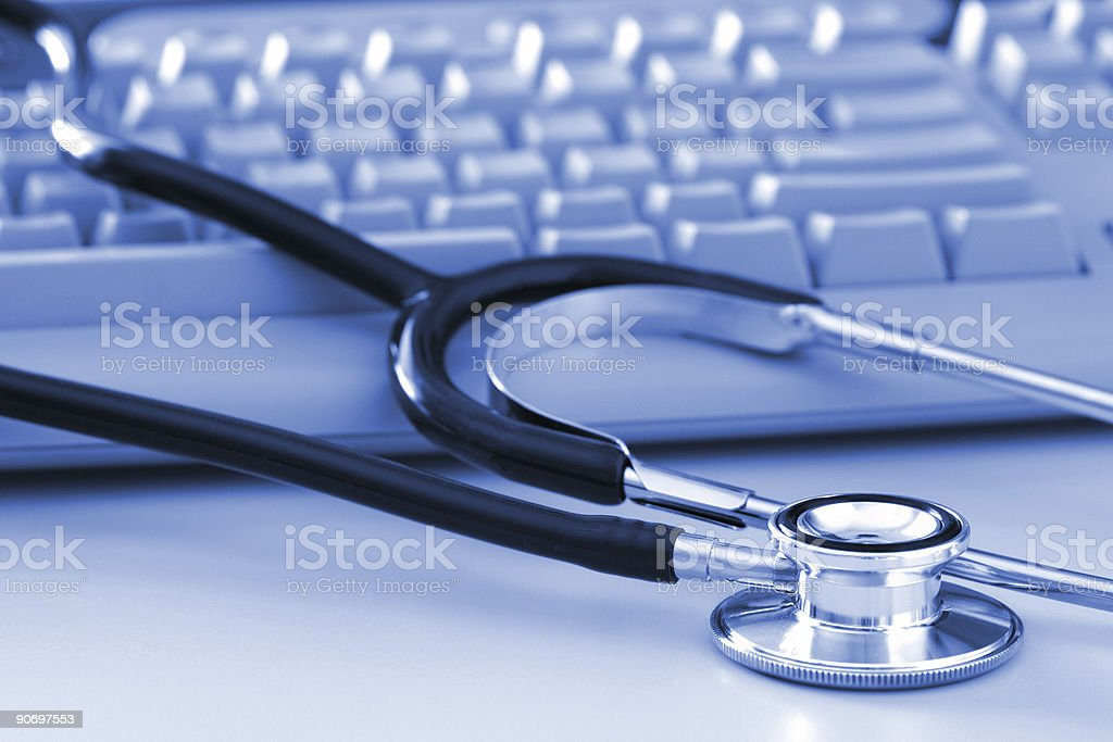 Stethoscope by Computer Keyboard stock photo