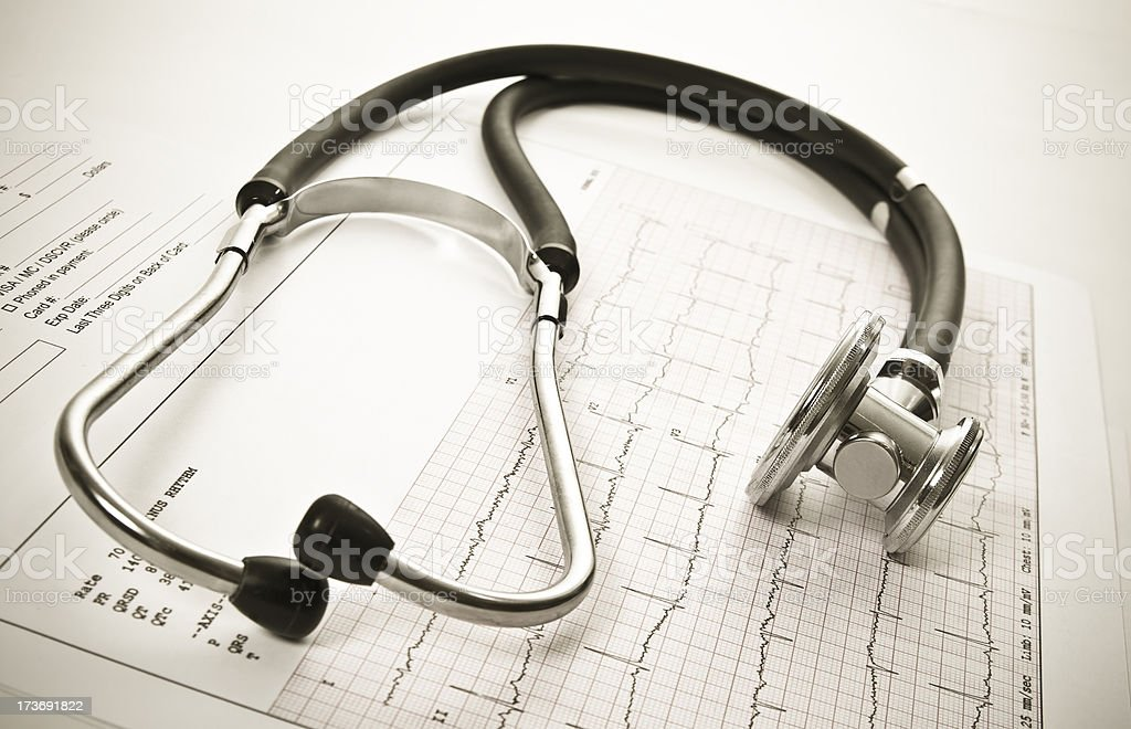 Stethoscope, EKG sheet and pacient receipt.Close-up. stock photo