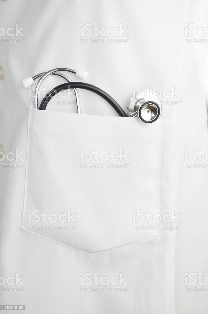 stethoscope In doctors lab coat pocket stock photo