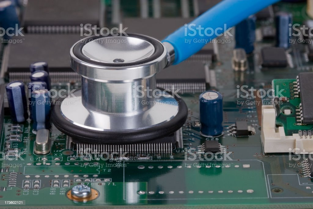 Stethoscope listening to a computer chip royalty-free stock photo