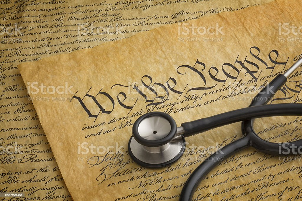 Stethoscope Lying on copy of the United States Constitution stock photo