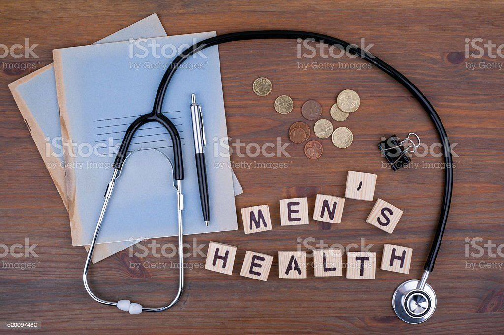 Stethoscope, money, pen with notebook and text stock photo