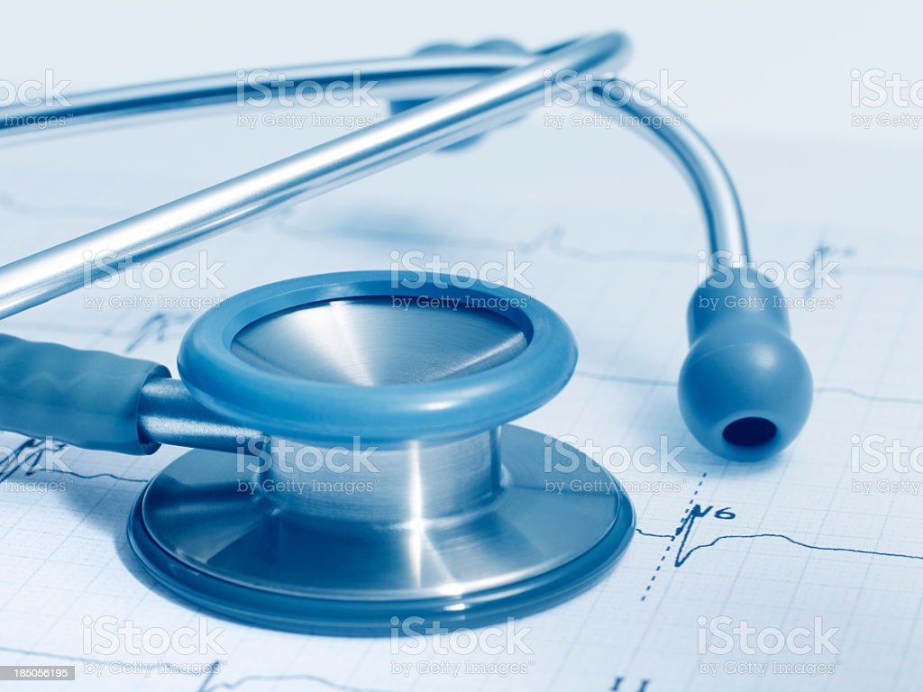 Stethoscope on a real ECG stock photo