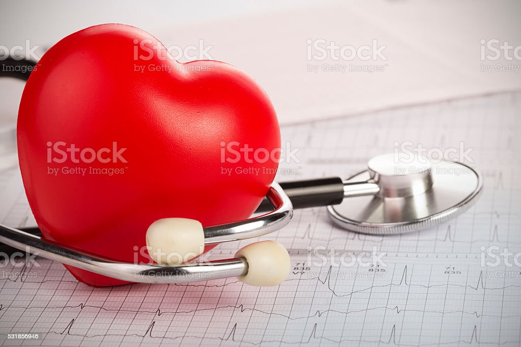 Stethoscope on an electrocardiogram (ECG) chart - stock photo