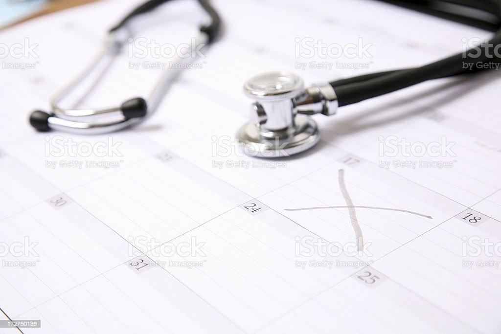 stethoscope on calendar royalty-free stock photo