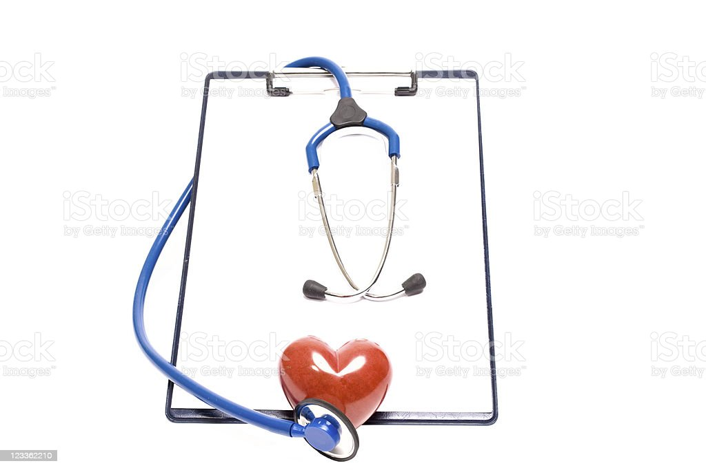 Stethoscope on clipboard with heart stock photo