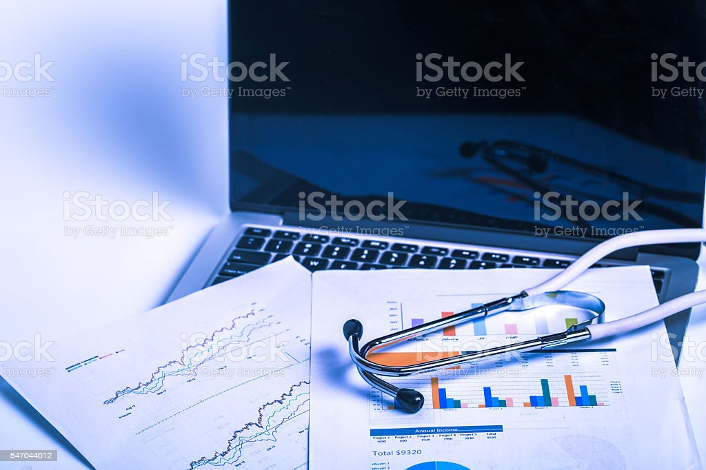 Stethoscope on computer keyboard stock photo