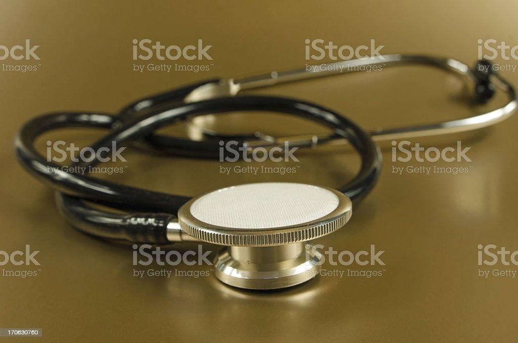 Stethoscope on Gold royalty-free stock photo