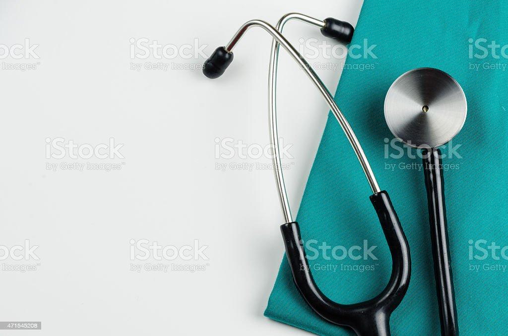 Stethoscope on green linen over white stock photo