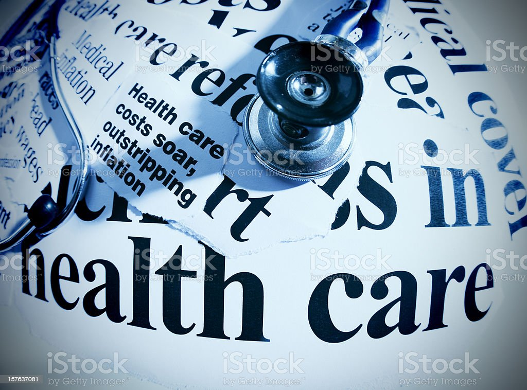 Stethoscope on healthcare headlines, shot with fisheye lens royalty-free stock photo