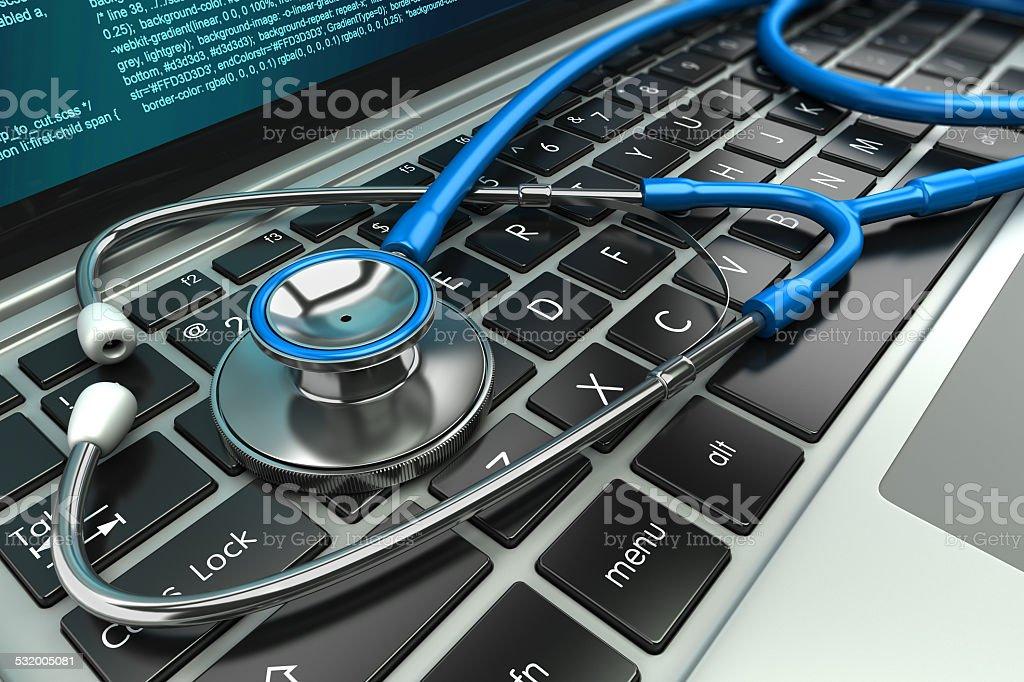 Stethoscope on laptop keyboard. Concept stock photo