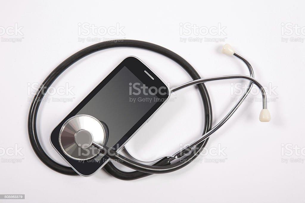stethoscope on mobile phone stock photo