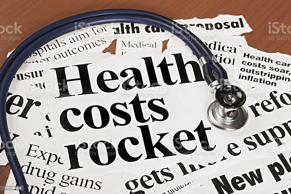 Stethoscope on newspaper headlines about health cost hikes royalty-free stock photo