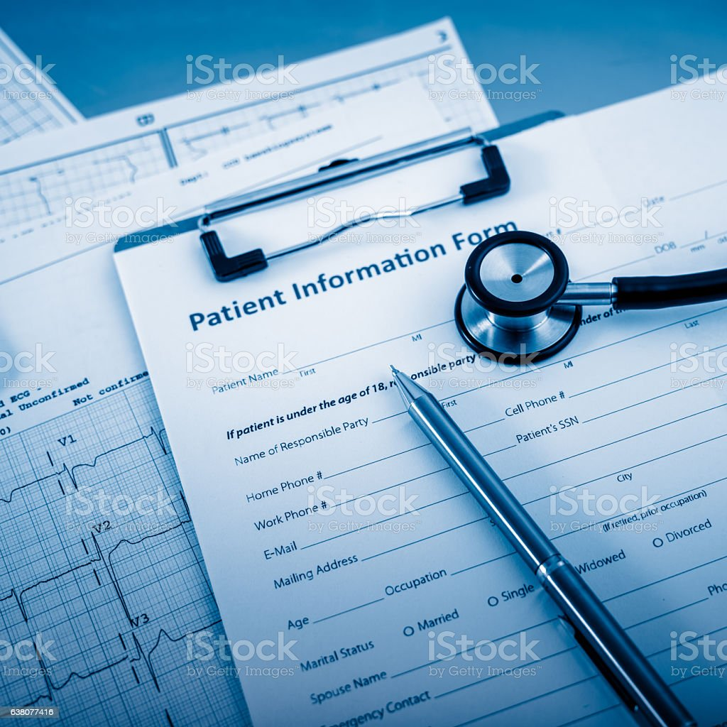 Stethoscope on patient information form stock photo